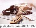 Electric guitar and headphones with music notes. 40140397