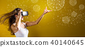 Technology Geometric Polygonal Spheres with woman using a VR 40140645