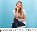 Portrait of a young woman sitting in a chair 40140772