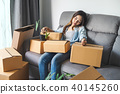 Young tried woman moving in new home 40145260