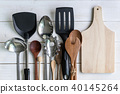 various kitchen utensils on wooden background 40145264