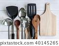 various kitchen utensils on wooden background 40145265