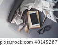 Cellphone, notebook and glasses on sofa 40145267