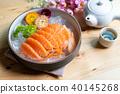 Salmon sashimi slice fresh serve on ice with tea 40145268