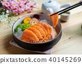 Salmon sashimi slice fresh serve on ice with tea 40145269