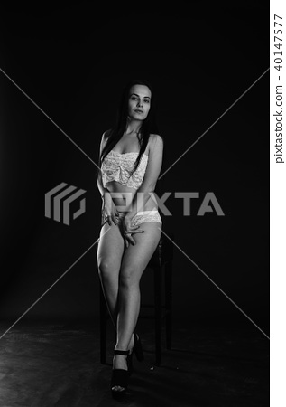 Young beautiful woman in a fashionable linen luxury brunette in the Studio. 40147577