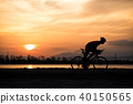 Silhouette a road bike cyclist man cycling 40150565