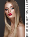 Beautiful blond girl with a perfectly smooth hair, classic make-up and red lips. Beauty face 40155330
