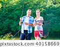 Couple sport fishing bragging with fish caught  40158669