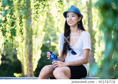 Young Asian woman smiling in the park 40158718