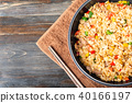 Fried rice with vegetables and pork in cooking pan 40166197