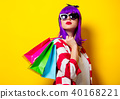 girl with purple hair holding shopping bags 40168221