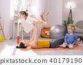 Alert mother and her children having fun 40179190