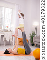 Delighted mummy doing exercises with her kid 40179322