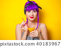 girl with purple hair holding lemonade cocktail 40183967