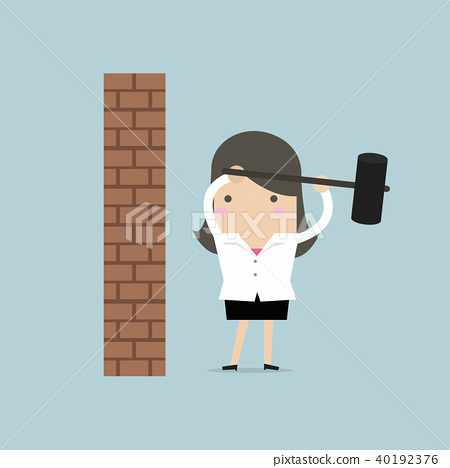 Businesswoman breaking wall with hammer. 40192376