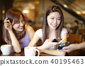 Woman paying with mobile phone in cafe shop 40195463