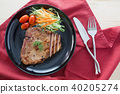 steak with salad and tomatoes on wood background 40205274