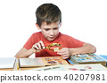 Boy with his collection of old postage stamps 40207981