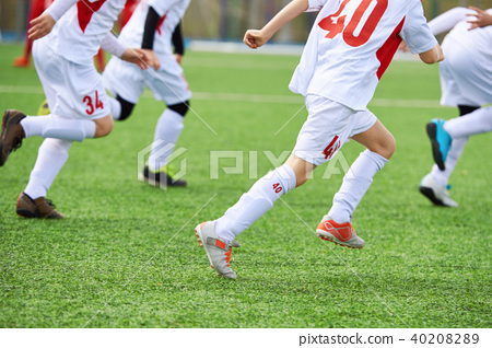 Children football players training on green field 40208289
