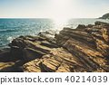 Seascape with rock in beautiful sunset. 40214039