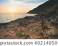 Seascape with rock in beautiful sunset. 40214050