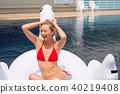 Bikini woman relaxation on swan 40219408