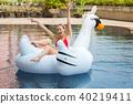 Bikini woman relaxation on swan 40219411