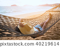 Happy woman relaxing in hammock 40219614