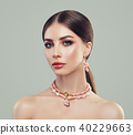 Fashion Portrait of Young Woman with Makeup  40229663