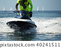 Lifeguard on a jet ski patrols the beach an ocean 40241511