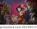 Statuette dancing geisha in the garden. Sakura wit 40248410