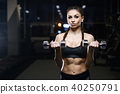 brunette athletic young girl working out in gym 40250791