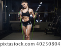brunette athletic young girl working out in gym 40250804