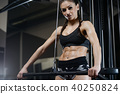 brunette athletic young girl working out in gym 40250824