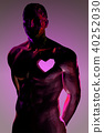 Polygonal man body with heart symbol on chest 40252030