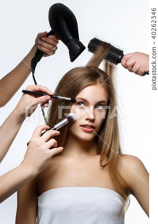 beautiful girl getting hair and makeup 40262346