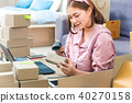 Young asian online seller working from home 40270158