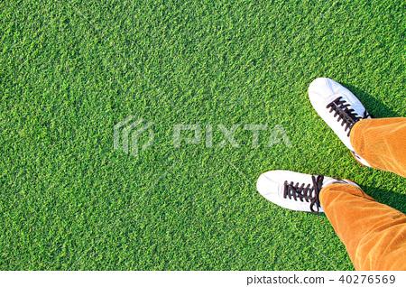 Artificial grass and feet 40276569