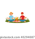 Young family couple having picnic at nature. People sitting on blanket and eating. Summer outdoor 40294687