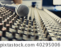 microphone on sound mixer, music background 40295006