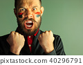 Portrait of a man with the flag of the Germany painted on him face. 40296791