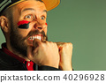 Portrait of a man with the flag of the Germany painted on him face. 40296928