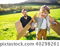 Happy toddler boy playing outside with father in spring nature. 40298261