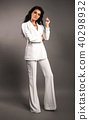 Woman in white suit 40298932
