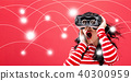 Network and connection technology concept with woman using a virtual reality headset 40300959