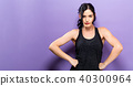 Powerful young fit woman on a solid background 40300964