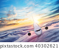 Passengers commercial airplane flying above clouds 40302621