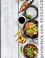 Asian food variation with many kinds of meals.  40302628
