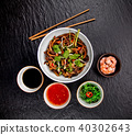 Asian udon noodles with spicy soy sauce 40302643